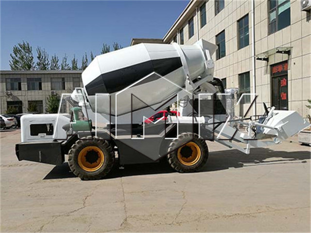 Self loading concrete mixer machine